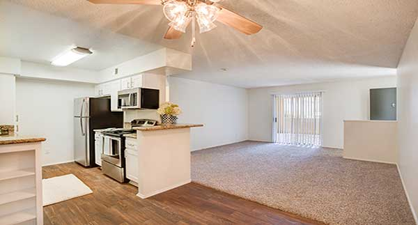 Waterstone Alta Loma Apartment living room, dining area, and kitchen